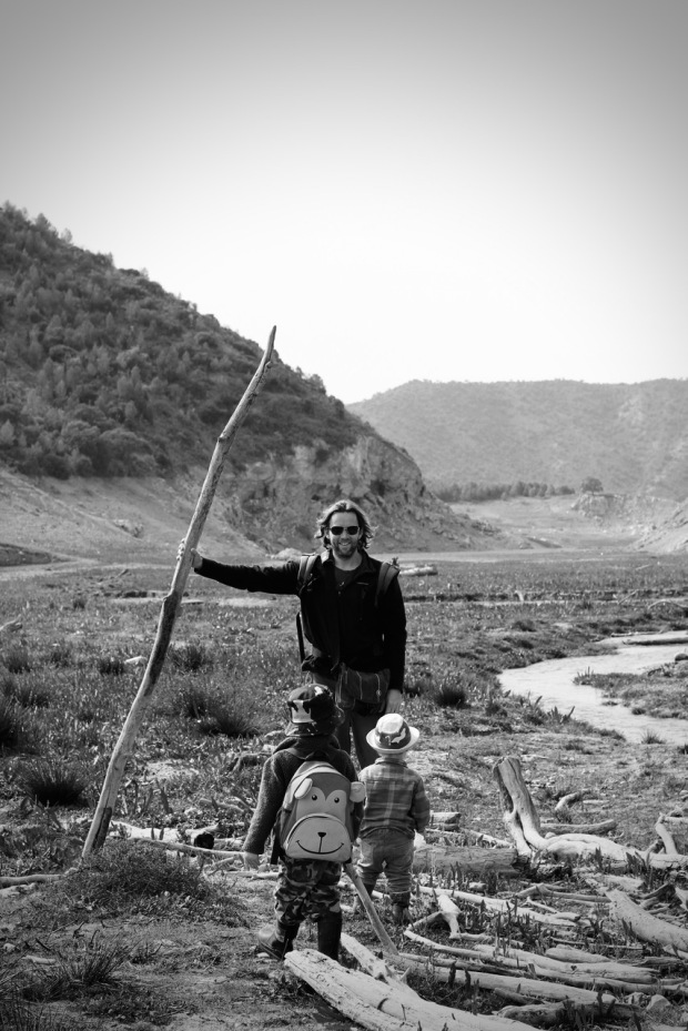 Daddy & Boys with Driftwood Raft B&W Photo by Topsy Turvy Tribe in Zagra, Granada, Andalucia, Spain