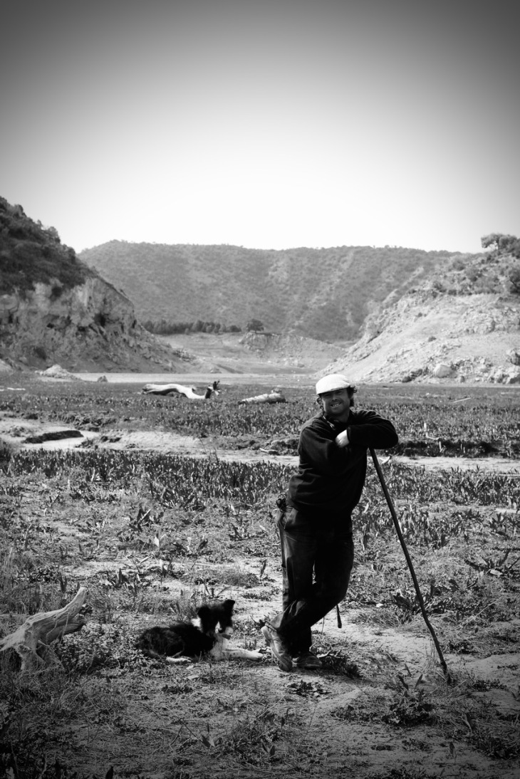 Valentino the Shepherd with sheepdog by Topsy Turvy Tribe B&W photo in Zagra, Granada, Andalucia, Spain