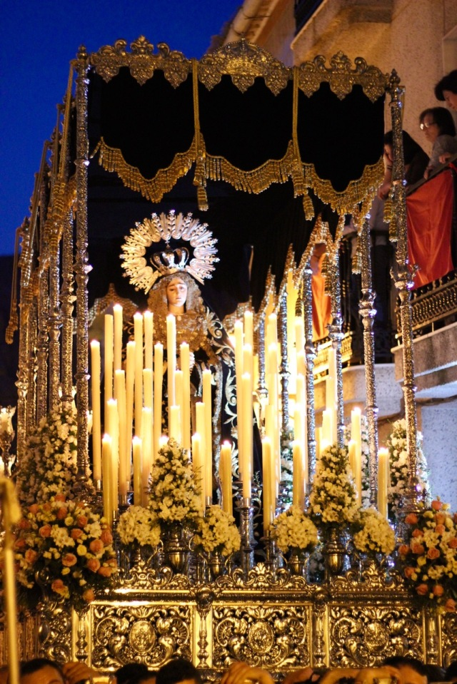 Mary statue being carried through the streets during Semana Santa in Loja Granada, Spain