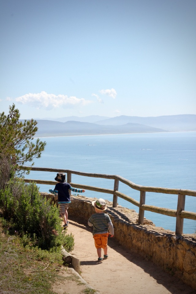 Boys running down a costal path. Parque Natural de la Brena y Marismas, Cadiz Province, Spa